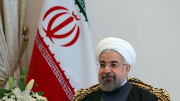 Sitting down for talks: Iranian President Hassan Rouhani.