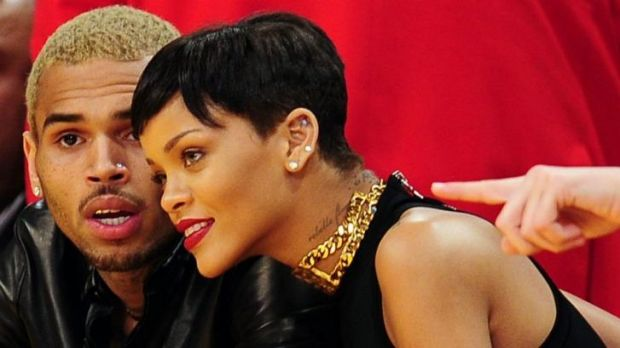 Happier times ... Chris Brown and Rihanna attend an NBA  game in 2012.