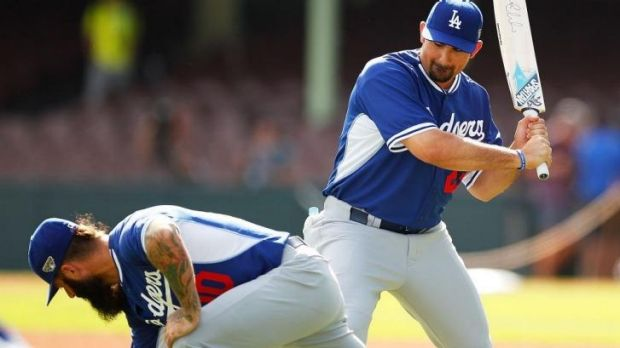 Adrian Gonzalez of the Dodgers gestures towards his teammate Brian Wilson with a cricket bat at the SCG on Tuesday.