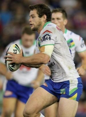 Staying: Shaun Fensom of the Raiders runs with the ball during the round two NRL match with the Newcastle Knights at ...