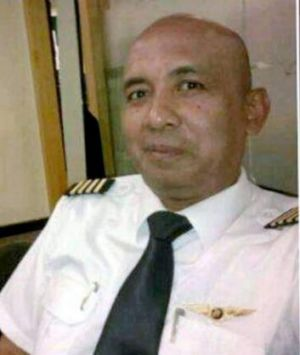 Did he try to turn the plane?  Zaharie Ahmad Shah, pilot of Malaysia Airlines flight MH370, seen in a photo posted to ...