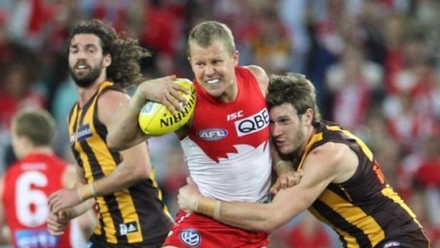 Caught: Ryan O'Keefe takes on the Hawthorn defence last year.