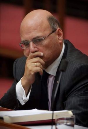 Senator Arthur Sinodinos announced he would stand aside as Assistant Treasurer on Wednesday.