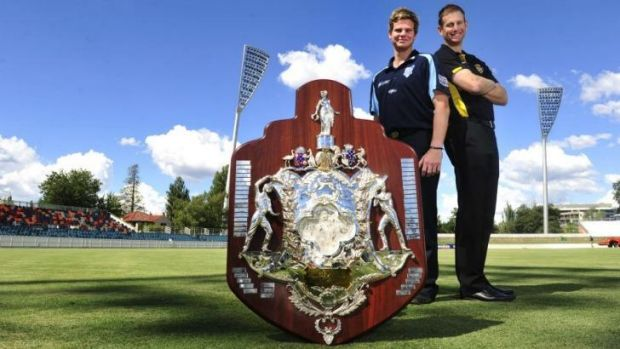 NSW captain Steve Smith with his WA opposite Adam Voges at Manuka Oval.