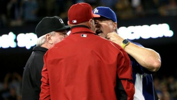 No love lost: Dodgers batting coach Mark McGwire has words with Arizona manager Kirk Gibson.