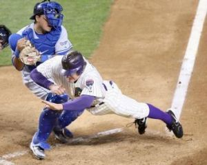 Fierce rivals: Los Angeles Dodgers catcher Dioner Navarro tags out Arizona Diamondbacks runner Eric Brynes.
