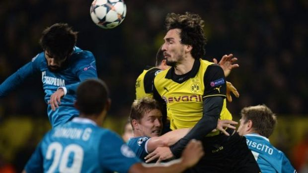 Aerial: Defenders Mats Hummels (R) of Borussia Dortmund and Tomas Hubocan (L) of Zenit St Petersburg clash for possession.