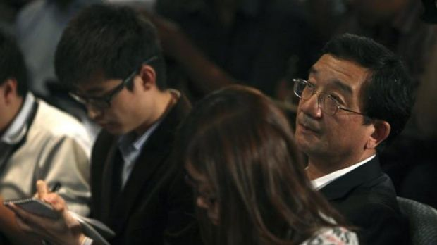 Chinese ambassador to Malaysia Huang Huikang, right, listens during a press conference about the missing flight.