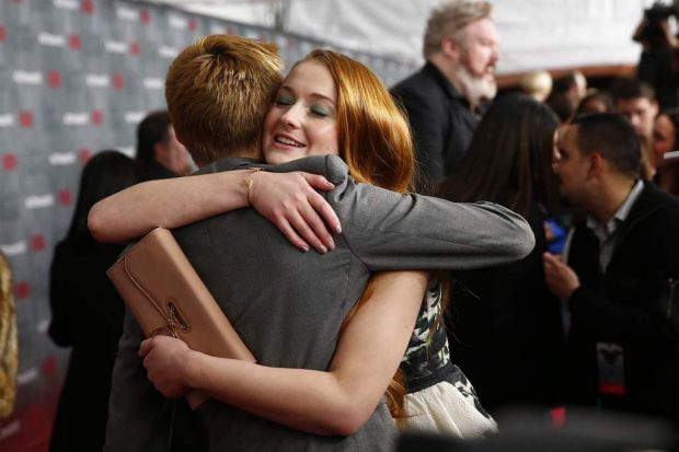Joffrey and Sansa get friendly ... Actors Jack Gleeson and Sophie Turner embrace at the premiere of <i>Game of ...