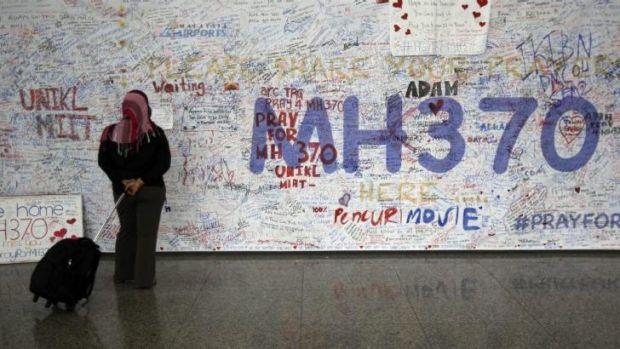 Messages for passengers aboard the missing Malaysia Airlines plane at Kuala Lumpur airport.