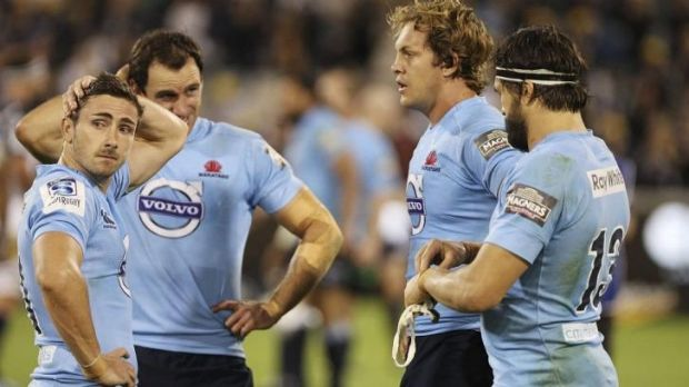 Reality check: Waratahs players react after the loss to the Brumbies.