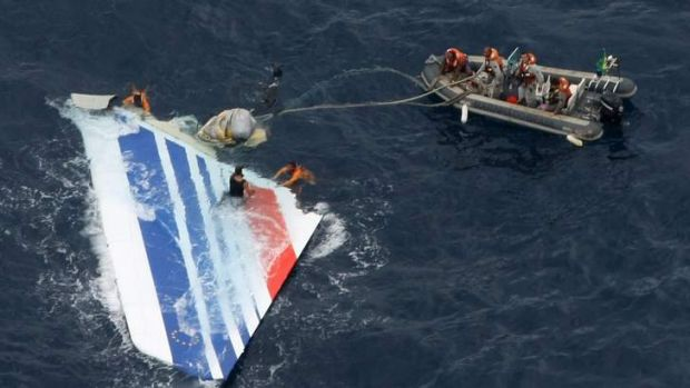 Sailors pick a piece of debris from Air France flight AF447 out of the Atlantic Ocean in 2009. It took two years to find ...