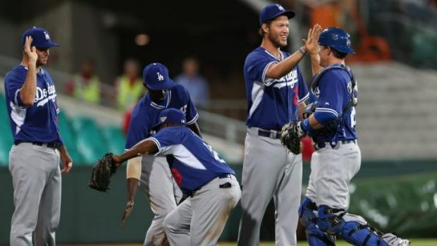 LA dodgers pitcher Clayton Kershaw and teammates celebrate their win.