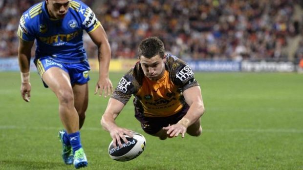 Corey Oates scores against the Eels in 2013.
