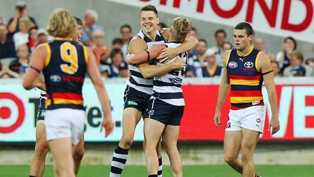 Earning his stripes: Hamish McIntosh celebrates a goal with Josh Caddy.