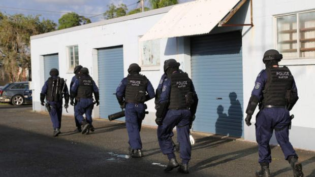 Police raid a Tweed Heads factory as part of a bikie crackdown on the Queensland-NSW border.