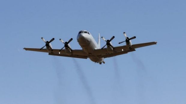 A Royal Australian Air Force P-3 Orion aircraft takes off in Perth to join the hunt for wreckage that may be from the ...