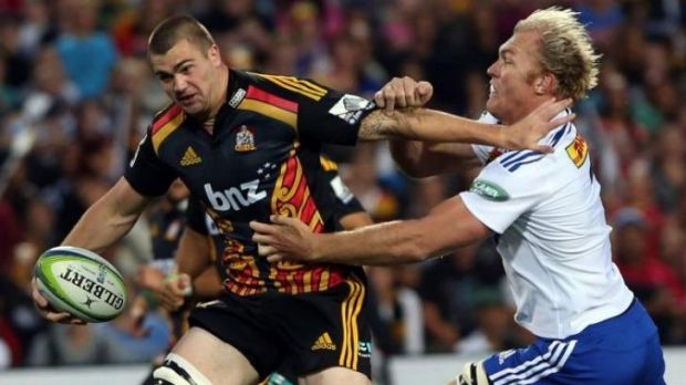 Rugged defender: Schalk Burger brings down Liam Squire of the Chiefs.
