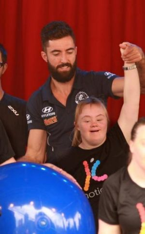 Up the Blues: Carlton's Kade Simpson joins the fun at World Down Syndrome Day on Friday.