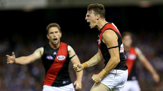 Pumped: Essendon's Brendon Goddard fires up the troops after kicking one of his three goals.