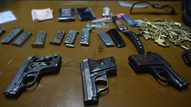 Hidden in socks ... Handguns used by the teenage attackers in the overnight Serena Hotel attack are displayed during a ...