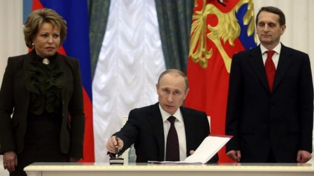 Expanding Russia ... President Vladimir Putin signs legislation on Friday that completed the process of absorbing Crimea ...
