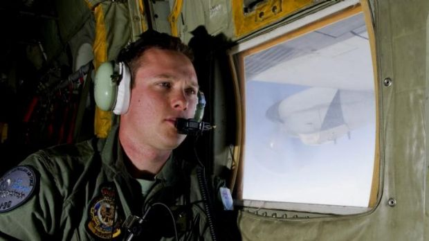 Using spotters to track debris ... RAAF Loadmaster Sergeant Adam Roberts scans the southern Indian Ocean on board a ...