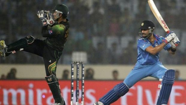 Virat Kohli steered India home in World Twenty 20 opener against Pakistan.