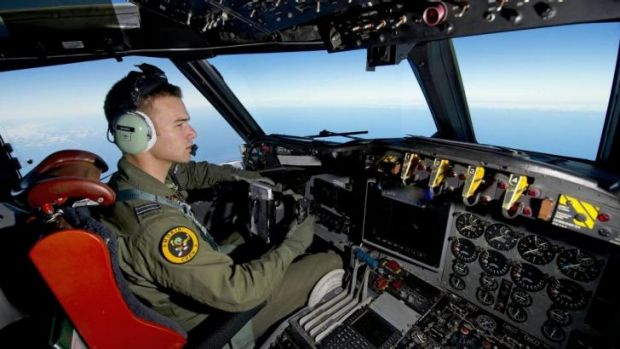 No strong leads as search continues: RAAF pilot Flight Lieutenant Russell Adams flies his AP-3C Orion over the Southern ...