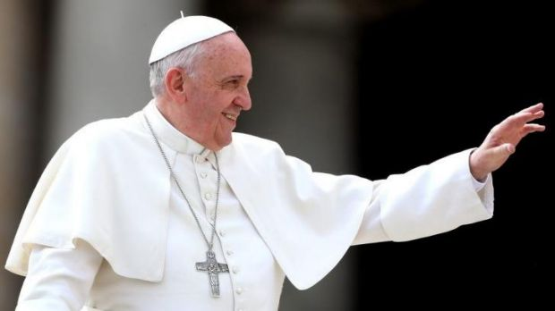 Pope Francis waves to the faithful.