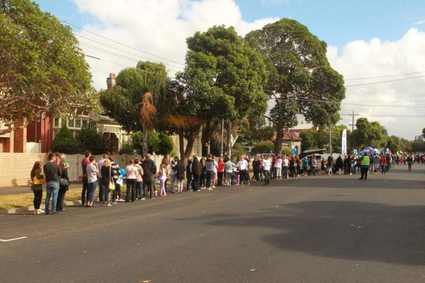 The Block fans join the queue which ran right around the corner and down Merton Street in Albert Park today.