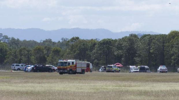 Emergency crews at the scene of a light plane crash at Caboolture Airport.