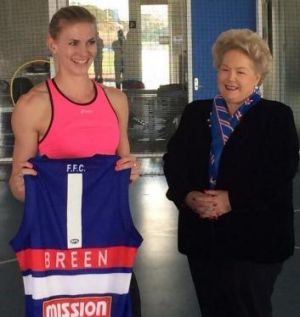 Australian sprint champion Melissa Breen gets presented with a jersey from Western Bulldogs vice-president Sue Alberti, ...