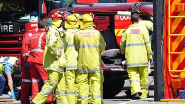 Emergency workers attend the crash that claimed the life of a Mandurah motorcyclist.