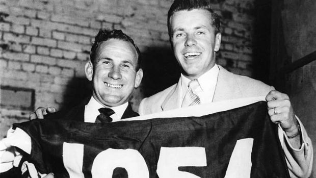 Charlie Sutton and Ted Whitten with the 1954 premiership flag.