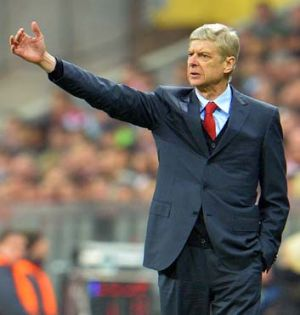 Guiding hand: Arsene Wenger, approaching his 1000th game, says each loss still leaves a scar.