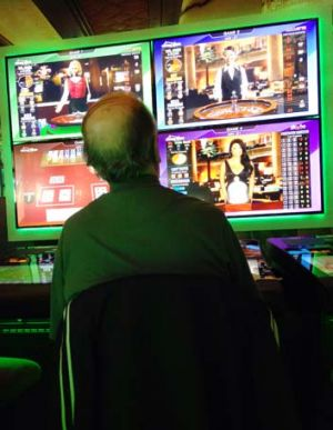 Pokies: A man plays one of Mount Pritchard's Mounties 560 machines.
