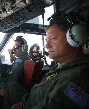 Flight Lieutenant Adam Francki and Warrant Officer Brenton Bell in the cockpit.