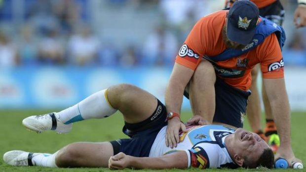 Greg Bird of the Titans screams in pain after injuring his shoulder against the Tigers.