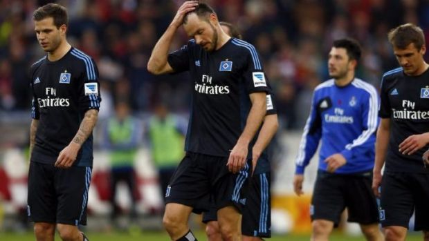 Desperate: Hamburg's Michael Westermann (C) and team mates react after their loss.