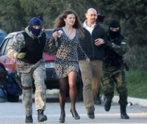 Passersby at the Ukrainian airbase at Belbek in Crimea are hustled away by Russian forces.