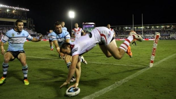 Try of the year?: Brett Morris scores an amazing try against the Sharks on Saturday night.