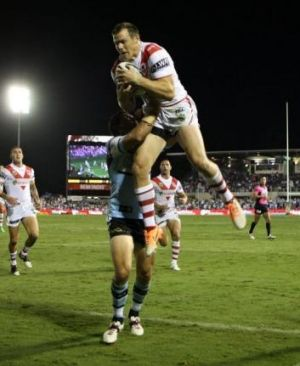 Over and above: Morris catches the bomb to begin his amazing try.