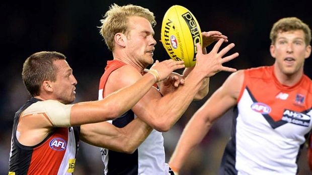 Front and centre: Demon Jack Watts marks despite Saint Jarryn Geary's efforts to spoil during St Kilda's 17-point win.