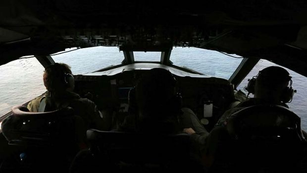 Pilots aboard a Royal New Zealand Air Force P-3K2 Orion aircraft searching the southern Indian Ocean for the plane on ...