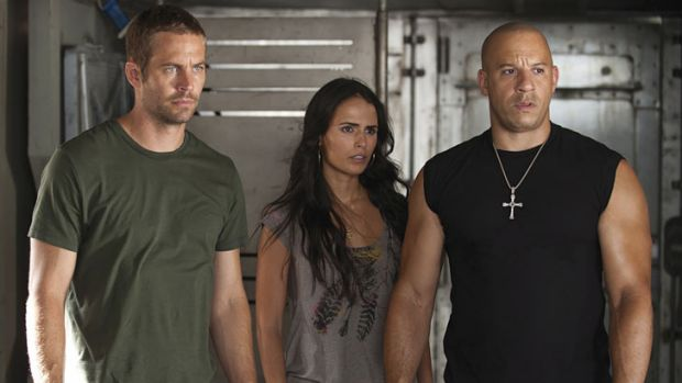 Walker, left, with co-stars Jordana Brewster and Vin Diesel in <i>Fast & Furious 5</i> (2011).
