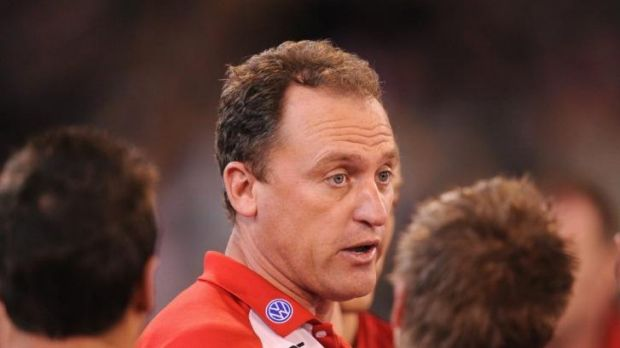 Staying on: Swans coach John Longmire.
