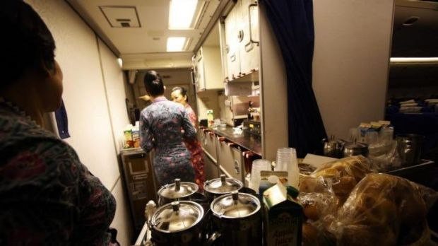 Cabin crew prepare to serve breakfast on MH318.