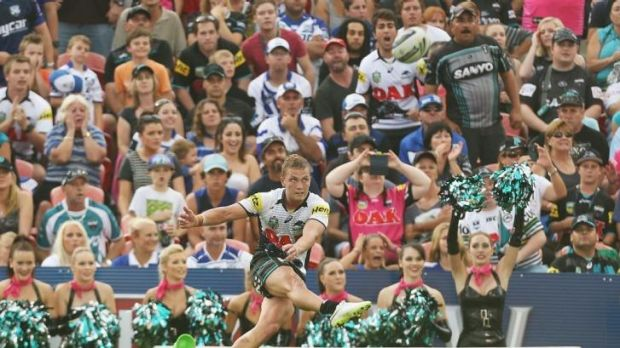 Matthew Moylan of the Panthers kicks a conversion to win the match against the Bulldogs on Saturday.
