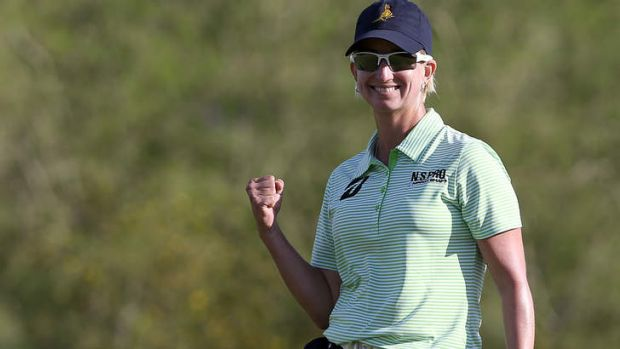 Karrie Webb of Australia celebrates a birdie on the 18th green as she fired a final round of 63.